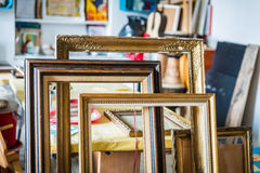 Old paintings frames. Old wooden painting frames in painter studio Stock Image