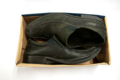 Old pair of black male shoes in box Stock Image