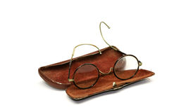 Old pair of glasses. With case on a white background Royalty Free Stock Photography