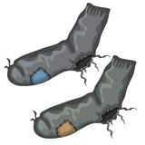 Old pair of holed socks with patches Royalty Free Stock Photos