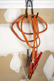 Old pair of jumper cables hanging in a garage Royalty Free Stock Images