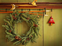Old pair of skis hanging with wreath Royalty Free Stock Images