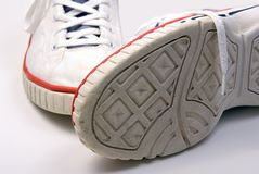 Old pair of sneakers Stock Images