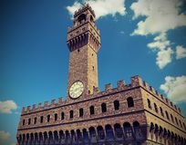 Old Palace and clock tower with blue sky in Florence Italy Royalty Free Stock Photography