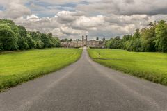 An old palace in the distance, a long straight road. royalty free stock photos