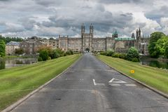 An old palace in the distance, a long straight road. stock photography