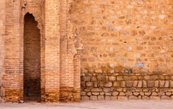 Old palace wall. One of the side-walls of famous Koutoubia Mosque, Marrakesh, Morocco royalty free stock image