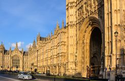Old Palace Yard and silver taxi cab. Old Palace Yard and the Gothic Revival style Palace of Westminster, with the statue of Richard Coeur de Lion, silver British stock photo