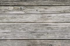 Old pale grey wood board with cracks and knots Royalty Free Stock Images