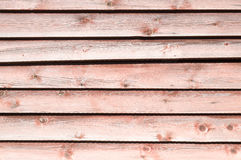 Old pale red wooden wall with peeling paint Royalty Free Stock Photography