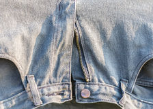 Old Pallid Blue Jeans. On Clothes Line Stock Photos
