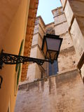 Old palma. An Old lamp post is framed by the magestic walls of Palma Cathedral Stock Image