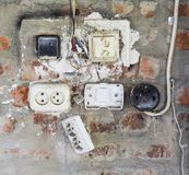 Old panel with switches and sockets. Old electrical wiring Stock Photo