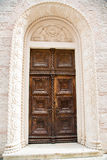 Old Paneled Door in White Stone Building Stock Images