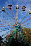 Old panorama wheel. In autumn and blue skies royalty free stock image