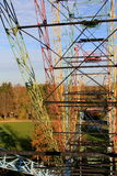 Old panorama wheel inside. Old panorama wheel in autumn with yellowish trees and blue sky from inside of the cabin royalty free stock photography