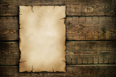 Old paper. On a wooden background Stock Images