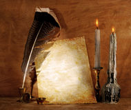 Old paper. With a candle and a quill pen stock photos