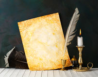 Old paper. With a candle and a quill pen royalty free stock images