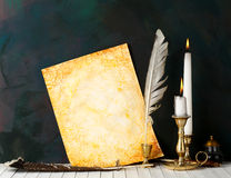 Old paper. With a candle and a quill pen royalty free stock photo