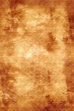 Old paper. Old, burned paper background, sepia tones stock images