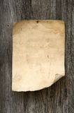 Old paper. On wood background stock photo