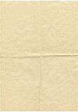 Old paper. Old and worn yellow paper royalty free stock photography