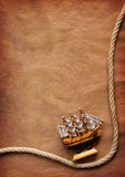 Old paper. Aged Rope and ship on the old paper background Royalty Free Stock Images
