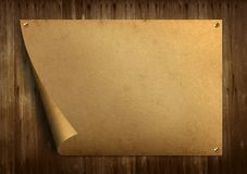 Old paper. On old wood background royalty free stock image