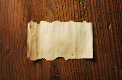Old paper. On wooden background stock photo