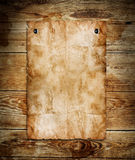 Old paper. On the wood background royalty free illustration