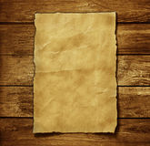 Old paper. And brown wood texture royalty free stock photo