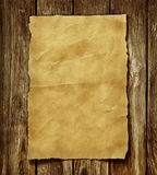 Old paper. And brown wood texture stock illustration