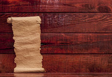 Old paper on aged wood Royalty Free Stock Photography