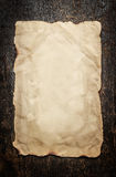 Old paper on a aged wooden background. Frame stock photo