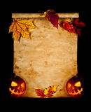 Old paper with autumn leaves and pumpkin. Halloween royalty free stock images