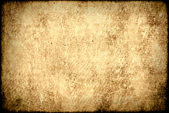 Old paper background. Old grungy worn paper background stock image