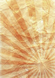 Old Paper Background. Crumpled and old paper background with sunburst Royalty Free Stock Photos