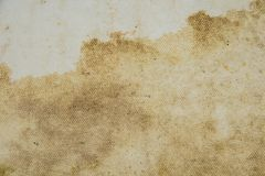 Old paper background and beige fabric canvas texture with stains. Old paper background and beige fabric canvas texture with stains royalty free stock photo