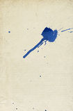 Old paper background blue ink stain. Royalty Free Stock Photos