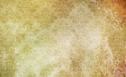 Old paper background with floral patterns. Old grunge paper background with floral patterns. Natural old paper texture Stock Photos