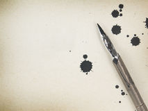 Old paper background. With ink and quill pen Royalty Free Stock Photos