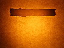 Old paper background - line bar (golden brown). Old sheet background with announcement bar. Burning hot golden brown toned Stock Photo