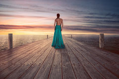 Old Paper. Beautiful Woman on a Jetty Stock Photography