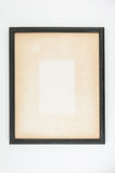 Old paper in black wooden picture frame. Stock Photo