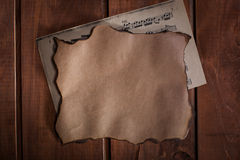 Old paper and a blanc with musical notes on wooden background Stock Photo