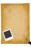 Old paper with blank photo frame Royalty Free Stock Images
