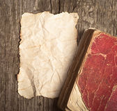 Old paper and book. On the wood background stock photos