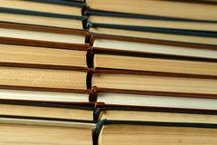 Old paper books with yellowed pages close up stock image