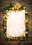Old paper bordering with christmas decoration Royalty Free Stock Photo